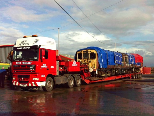 Photo of Class 502 vehicle 28361 on the back of a low loader