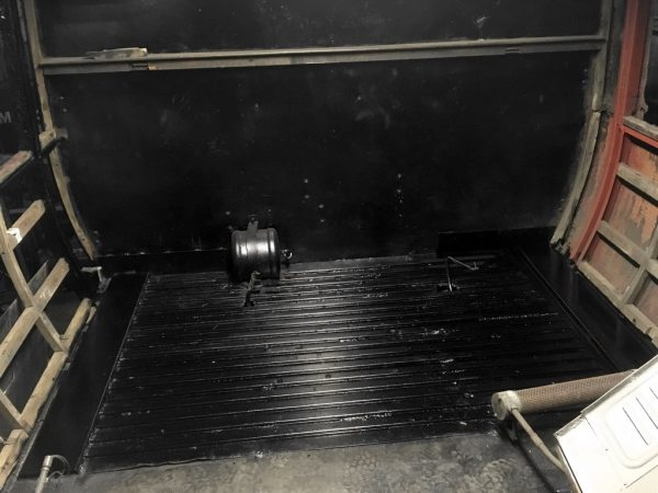 Photo of interior of vehicle 29896, stripped out but with freshly installed metal flooring