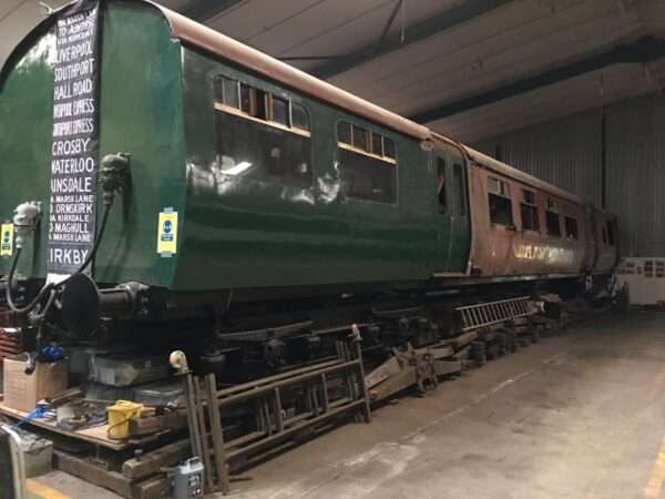 Photo of the 502 partly restored and partly painted green